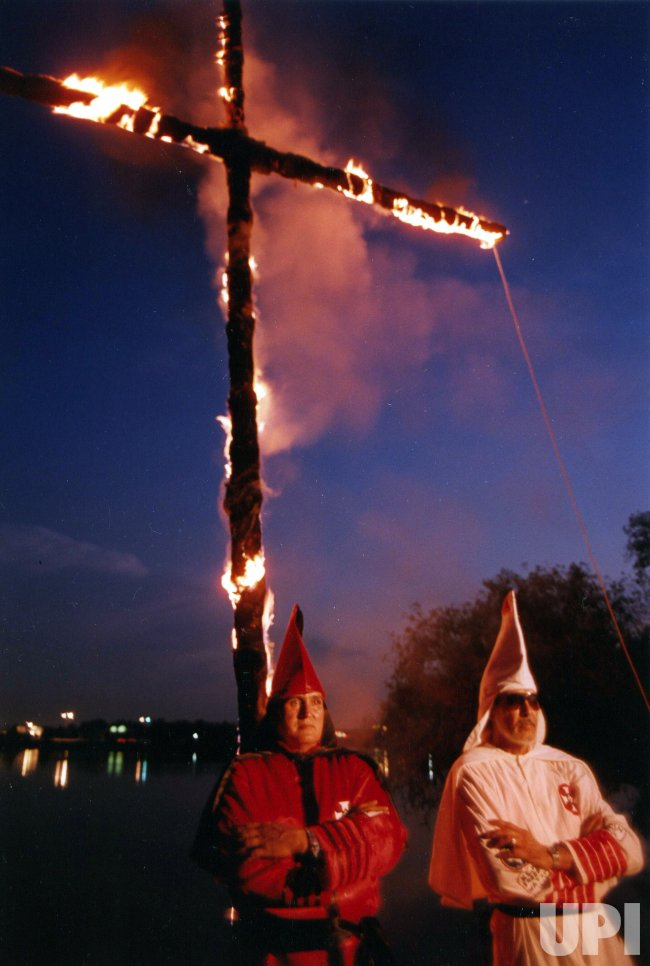 Members of a Texas chapter of the Ku Klux Klan burn a cross in celebration of the recent Supreme Court decision which said a law banning cross burning was unconstitutional.