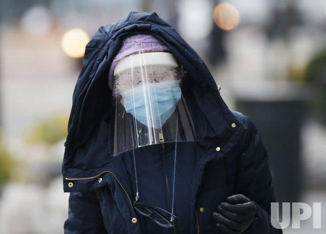 Pedestrians Wear Face Shields in New York