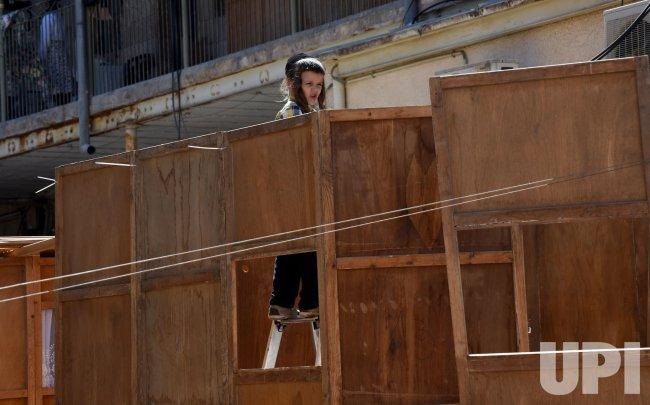 An Ultra-Orthodox Jewish Boy Stands Inside A Sukkah In Jerusalem