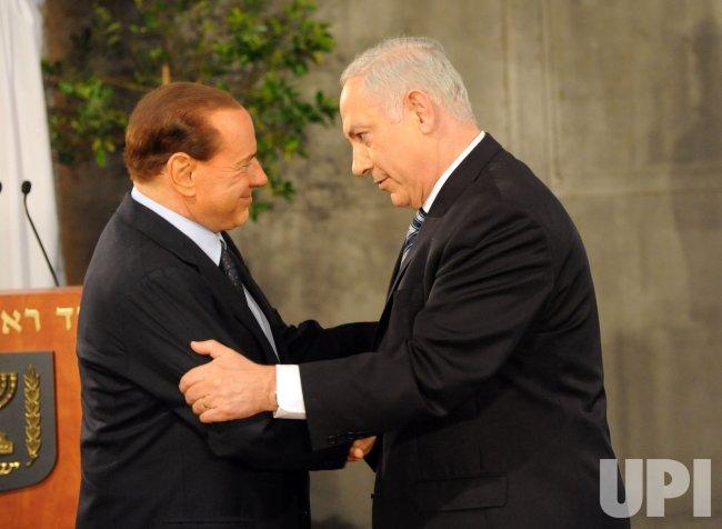 Israeli Prime Minister Benjamin Netanyau welcomes Italian Prime Minister Silvio Berlusconi in Jerusalem