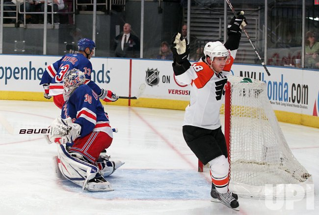 Philadelphia Flyers Mike Richards (18) reacts and skates past New York Rangers Henrik Lundqvist (30) after scoring a goal at Madison Square Garden in New York
