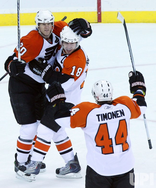 Philadelphia Flyers Chris Pronger (20) and Mike Richards celebrate with Kimmo Timonen at Prudential Center in New Jersey