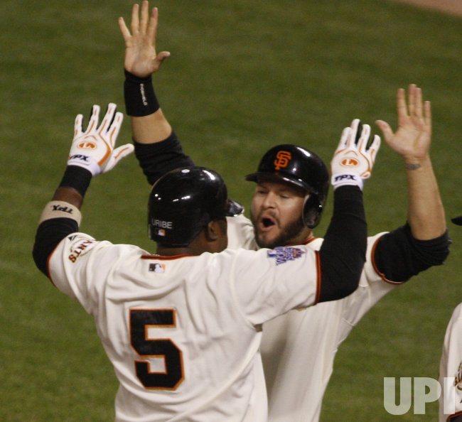 Giants Juan Uribe blasts a three run shot against the Texas Rangers in the World Series in San Francisco