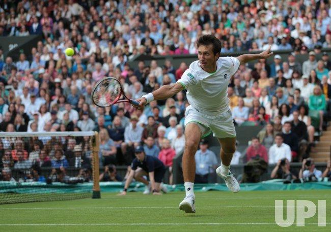 Sergiy Stakhovsky returns against Roger Federer at 2013 Wimbledon Championships