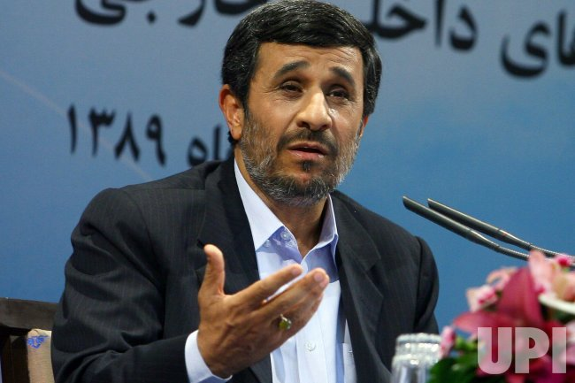 Iranian President Mahmoud Ahmadinejad holds a press conference in Tehran