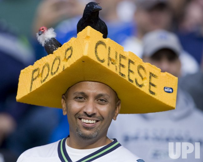 2290d2261 Seattle Seahawks fan makes fun of the Green Bay Packers cheese heads at CenturyLink  Field in Seattle