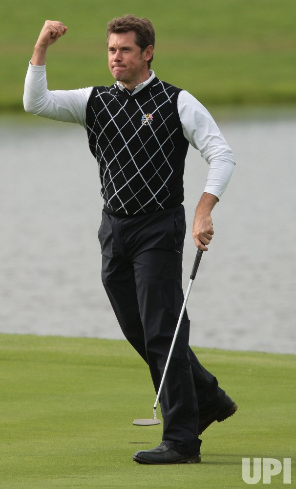 Westwood celebrates victory in foursomes on the third day of Ryder Cup.