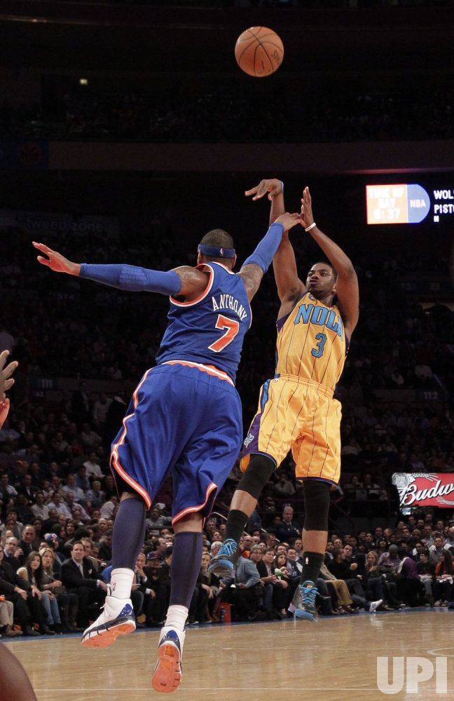New York Knicks Carmelo Anthony tries to block a shot from New Orleans Hornets Chris Paul at Madison Square Garden in New York