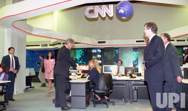 Bill Clinton meets with CNN's Ted Turner