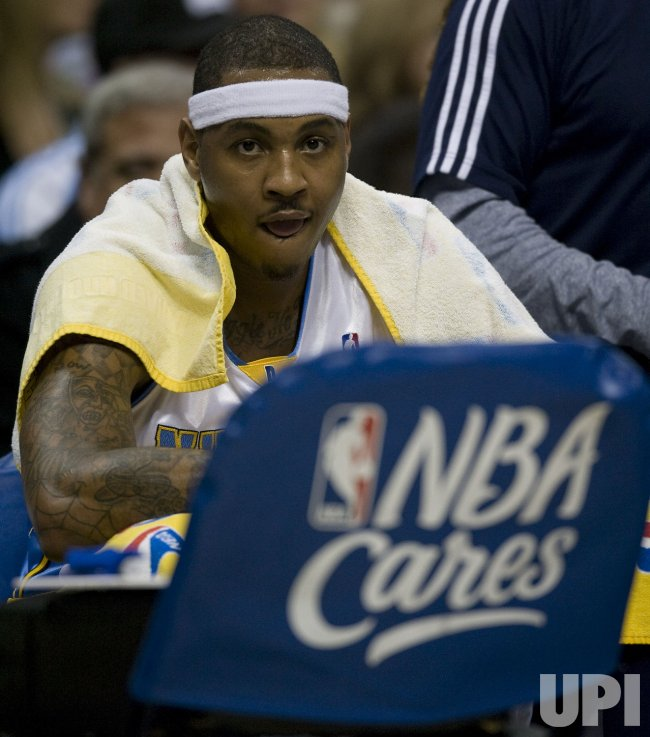 Nuggets Anthony Sits on Bench during a Timeout in Denver