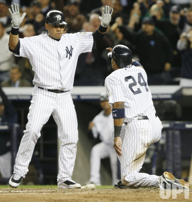 The New York Yankees Melky Cabrera reacts as Robinson Cano scores a run against the Minnesota Twinsin game 1 of the ALDS at Yankee Stadium in New York