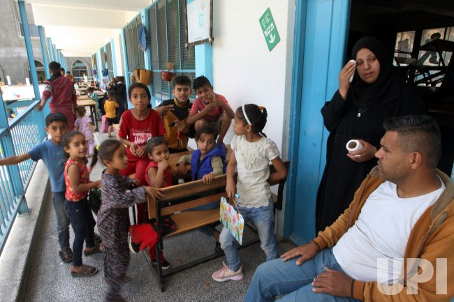 Families Take Shelter from Israeli Air Strikes in Gaza