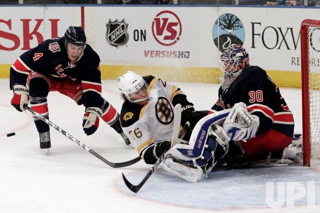 New York Rangers Michael Del Zotto (4) watches Boston Bruins Blake Wheeler slide into Henrik Lundqvist at Madison Square Garden in New York