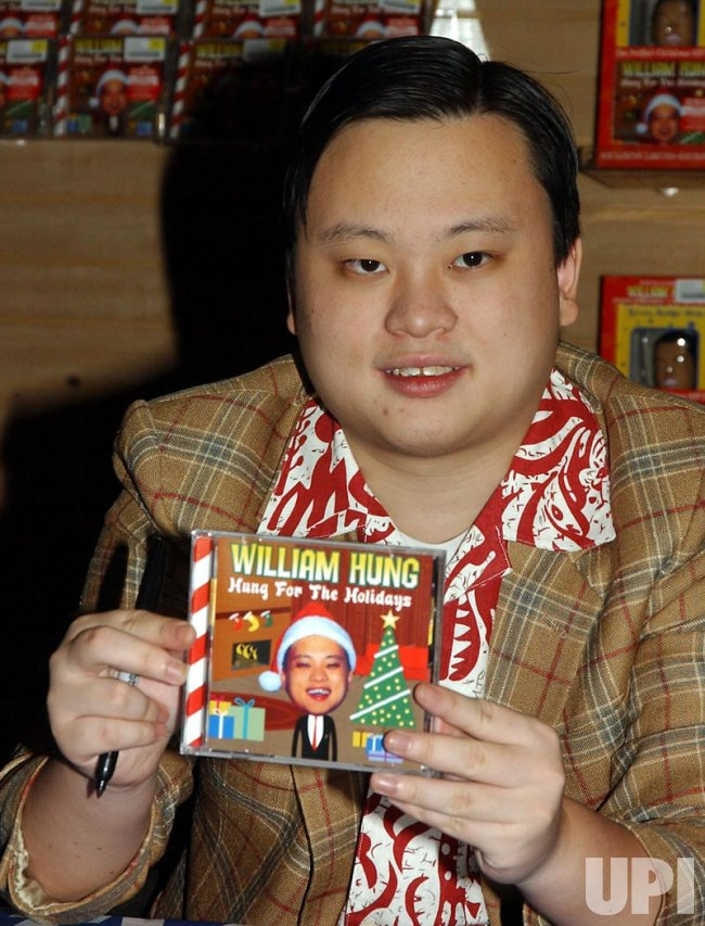 WILLIAM HUNG PROMOS HIS CHRISTMAS CD AND BOBBLEHEAD DOLL