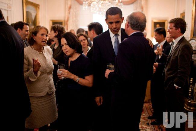 President Obama speaks with Interior Secretary Salazar at the Senior Staff retreat at the Blair House in Washington