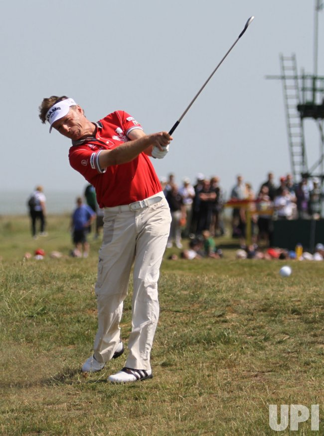 Bernhard Langer hits out of the rough on the 8th hole during the Open Championship in England.