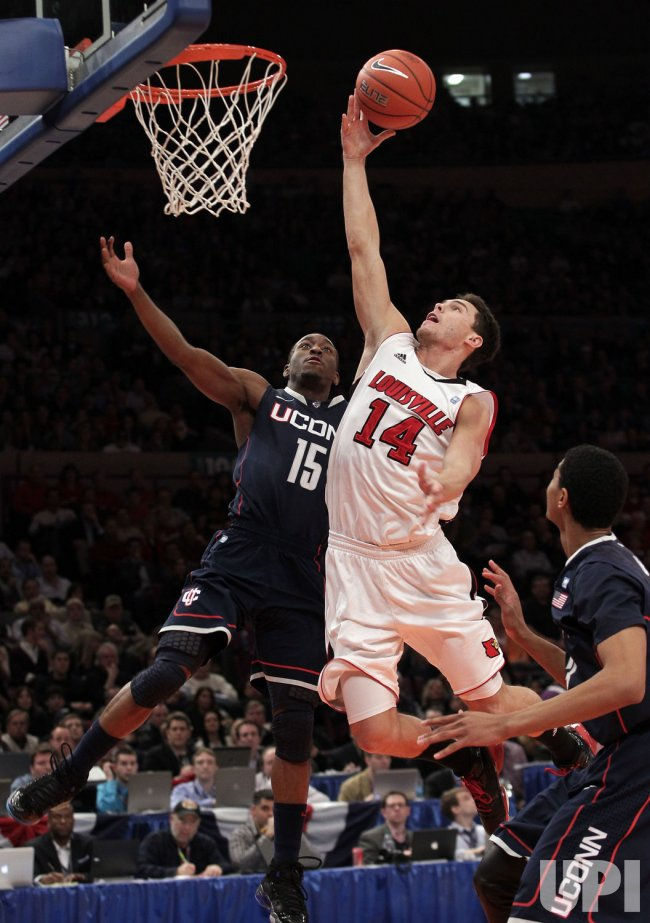 Connecticut Huskies Kemba Walker plays defense on Louisville Cardinals Kyle Kuric at the NCAA Big East Men's Basketball Championship Finals in New York