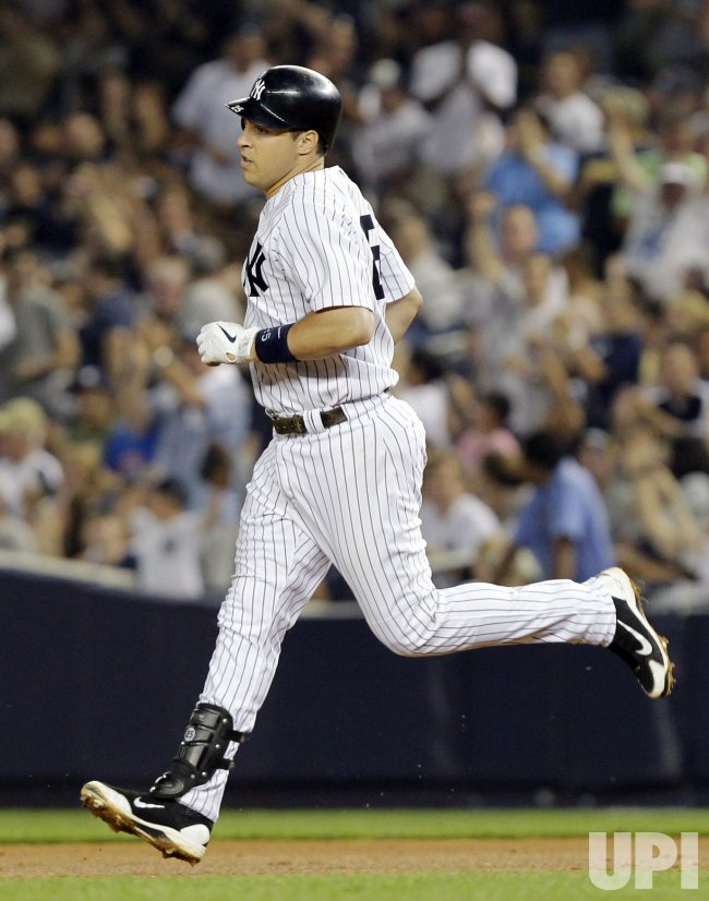 New York Yankees Mark Teixeira hits a home run at Yankee Stadium in New York