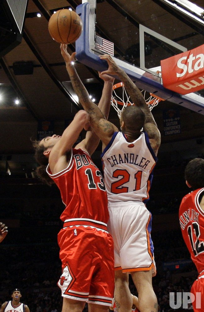 Chicago Bulls Joakim Noah plays defense while New York Knicks Wilson Chandler at Madison Square Garden in New York