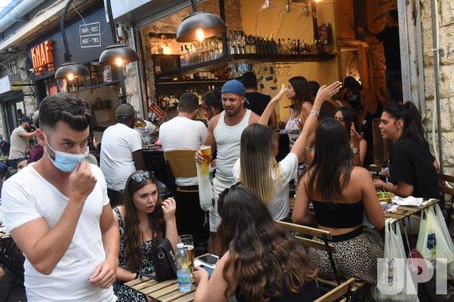 Israelis Crowd Into The Mahane Yehuda Market In Jerusalem