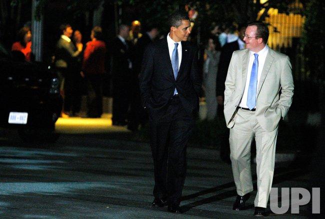 President Obama and Press Secretary Robert Gibbs walk from Blair House to White House in Washington