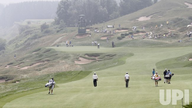 Weekley, Noh and Points walk up 4th hole during round 2 of the PGA Championship