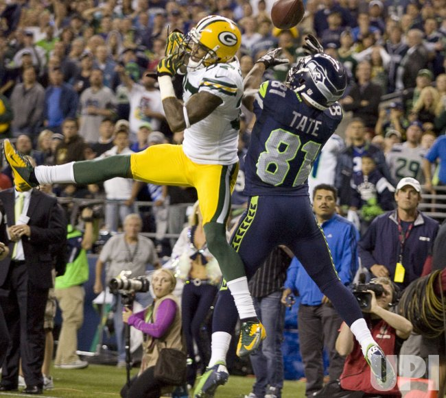 Green Bay Packers corner back Sam shields knocks the ball away from Seattle Seahawks wide receiver Golden Tate at CenturyLink Field in Seattle,.