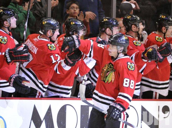 Blackhawks Kane celebrates 100th career goal against Sharks in Chicago
