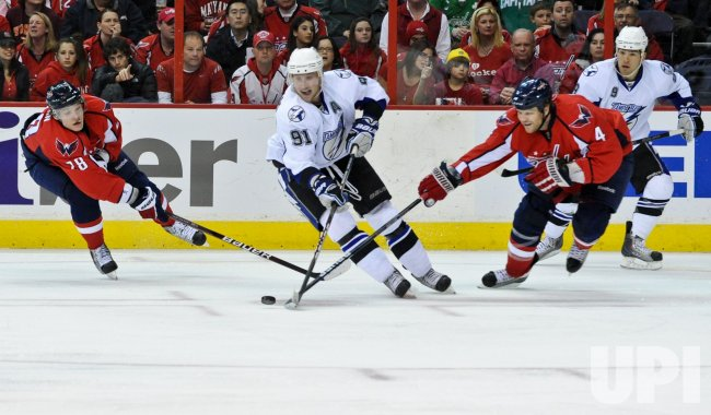 Capitals Semin and Erskine defend against Lightning Stamkos in Washington