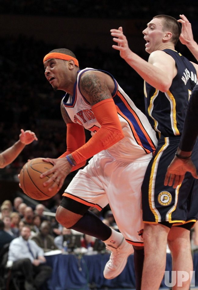 New York Knicks Carmelo Anthony (7) and Amar'e Stoudemire (1) try to alter the shot of Indiana Pacers Darren Collison at Madison Square Garden in New York