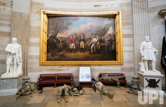 Members of the National Guard sleep inside the U.S. Capitol