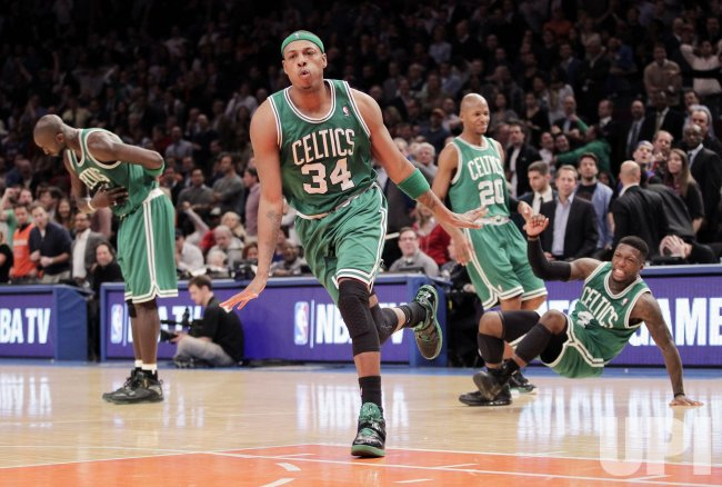 Boston Celtics Kevin Garnett, Paul Pierce, Ray Allen and Nate Robinson (R) react at Madison Square Garden in New York