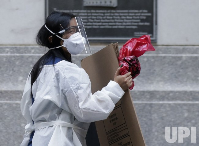 A Woman Wears a Face Mask in New York City