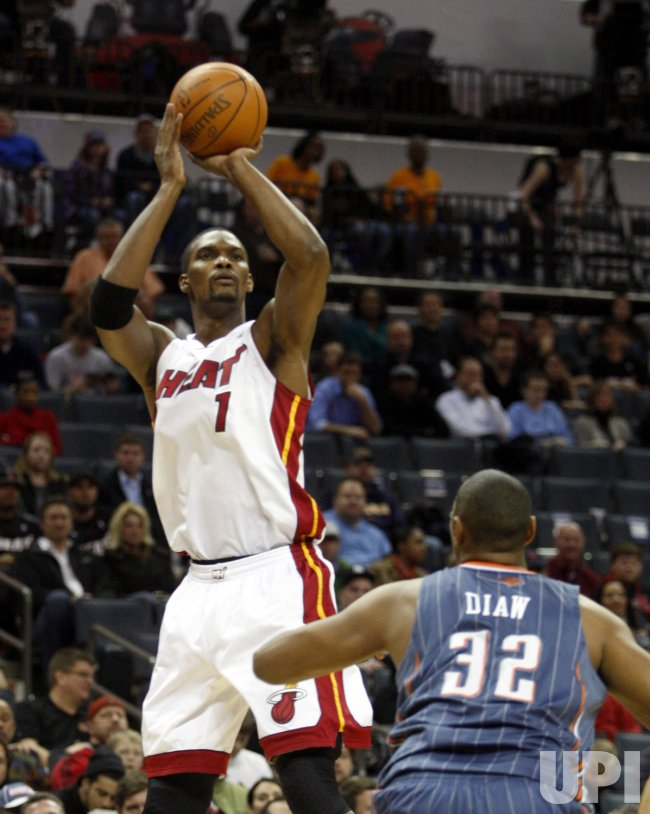 Miami Heat's Chris Bosh shoots against the Charlotte Bobcats