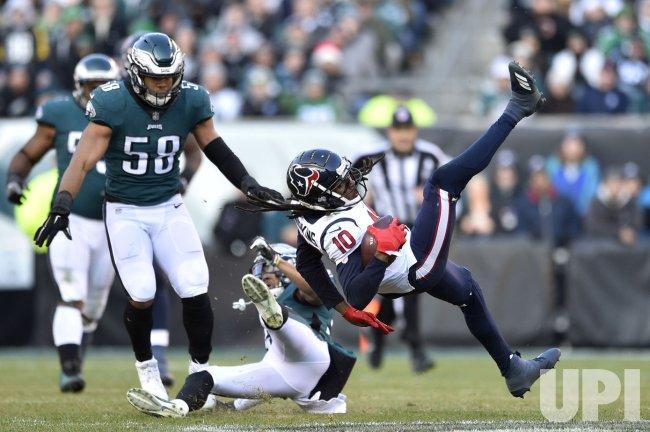Texans' DeAndre Hopkins is up ended by Eagles safety Tre Sullivan