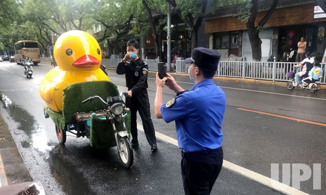 A Giant Duck is Removed by Police in Beijing, China