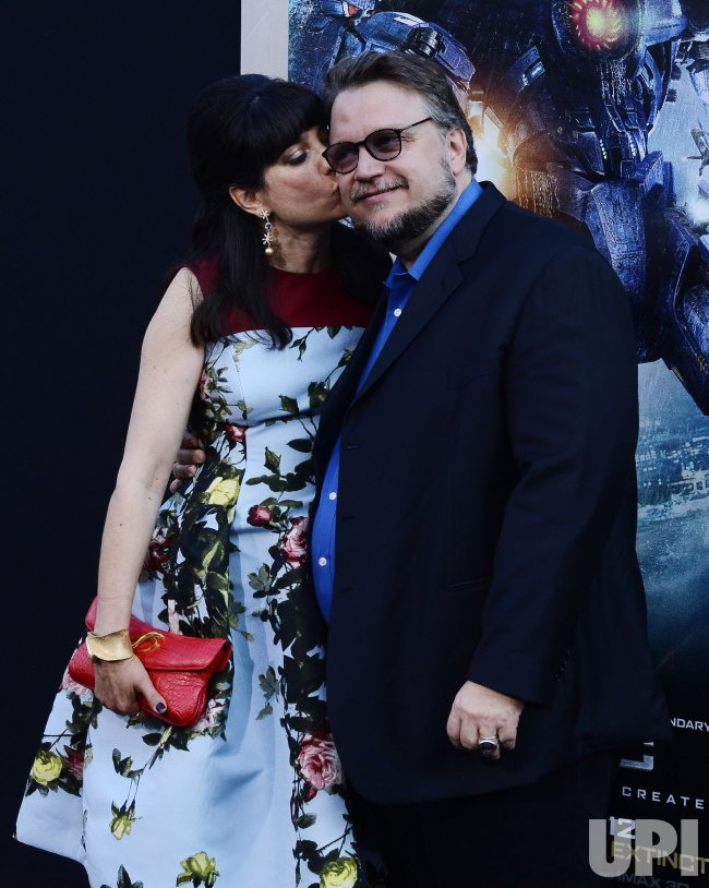 "Guillermo del Toro and Lorenza Newton attend the ""Pacific Rim"" premiere in Los Angeles"