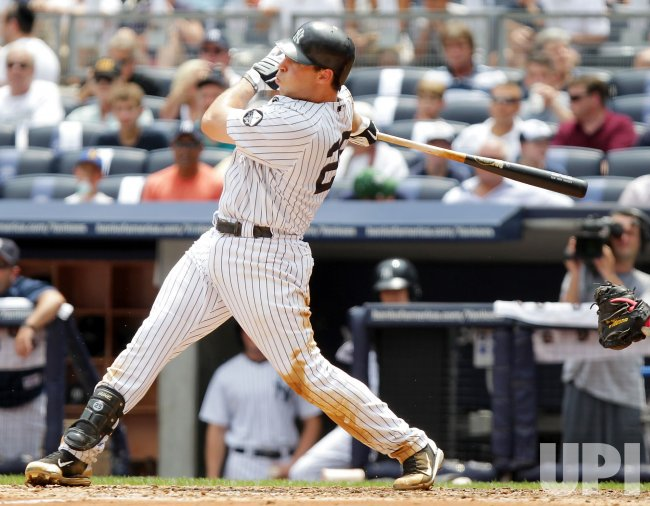 New York Yankees Mark Teixeira drives in 2-runs with single at Yankees Stadium in New York