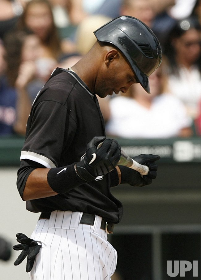 Chicago White Sox's Alexei Ramirez looks at his bat after striking out against the Boston Red Sox in Chicago