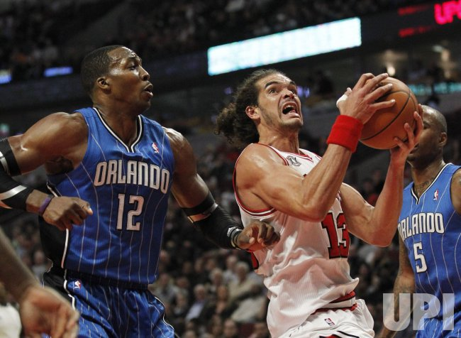 Bulls Noah drives past Magics Howard in Chicago