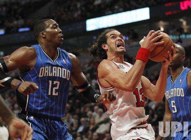 Bulls Noah drives past Magics Howard in Chicago