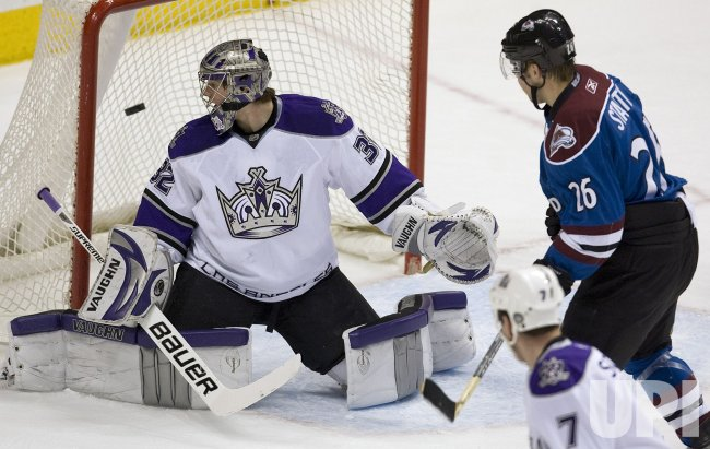 Avalanche's Stastny Watches Goal Against Kings Goalie Quick in Denver