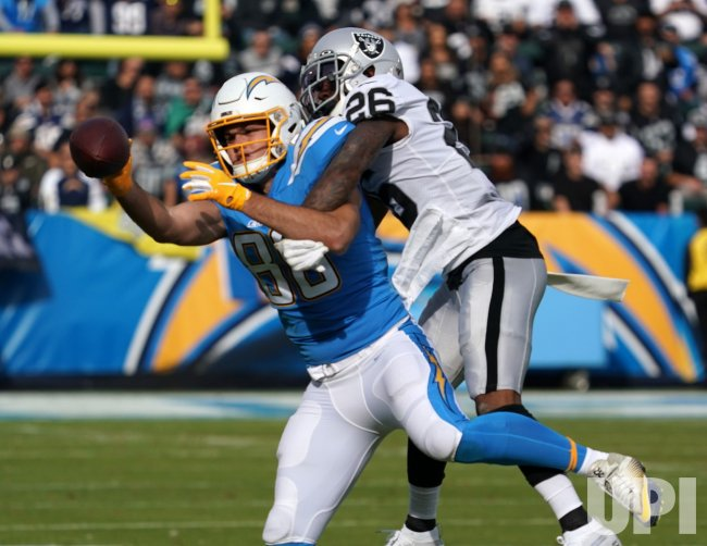 Los Angeles Chargers' Hunter Henry (L) can't pull in pass as Oakland Raiders Nelson Lawson knocks the ball away