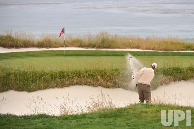 Ernie Els hits from a bunker on the 10th hole during the U.S. Open in Pebble Beach, California