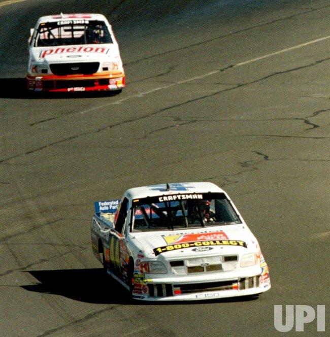 Driver Boris Said pulls ahead of Tom Hubert during the Kragen/Exide 151