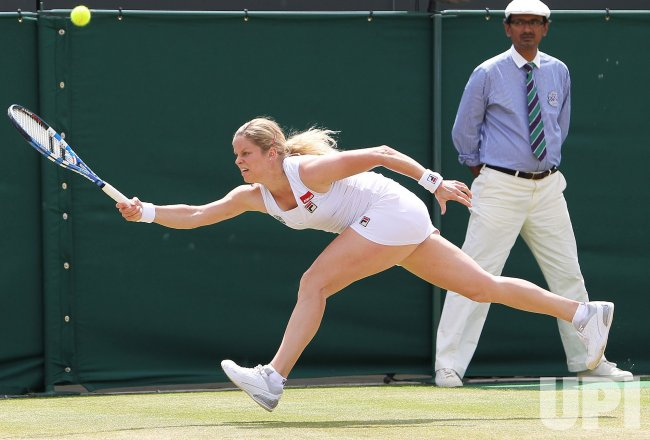 Kim Clijsters stretches for the ball at the Wimbledon Championships
