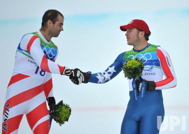 Switzerland's Didier Defago shakes hands with USA's Bode Miller in Whistler