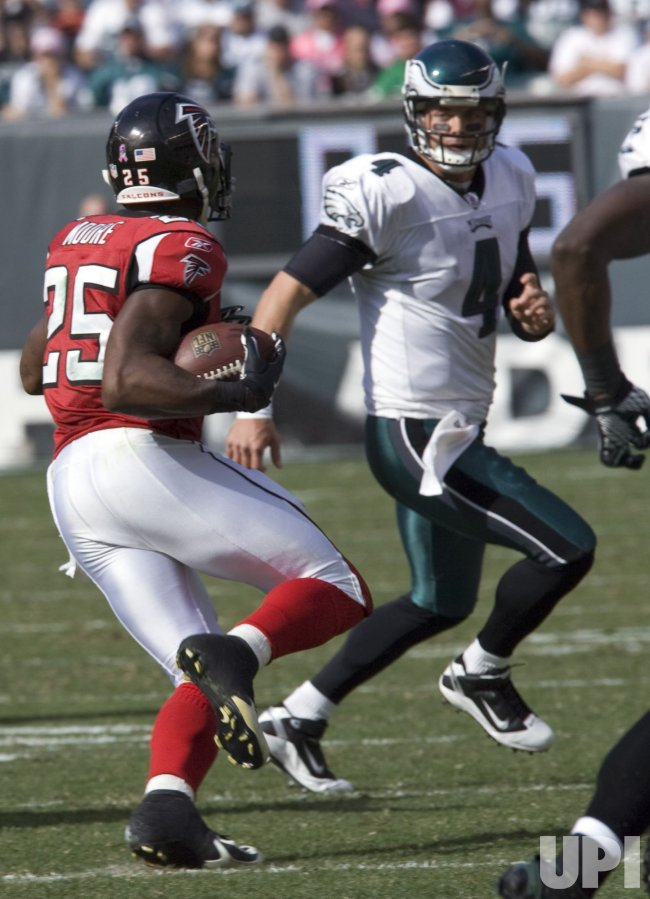 Atlanta Falcons William Moore intercepts pass by Kevin Kolb in second quarter.