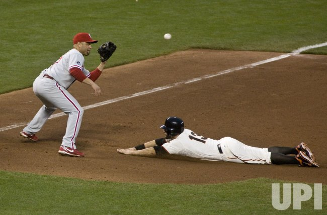 Phillies Placido Polanco gets GiantsCody Ross in game five of the NLCS in San Francisco