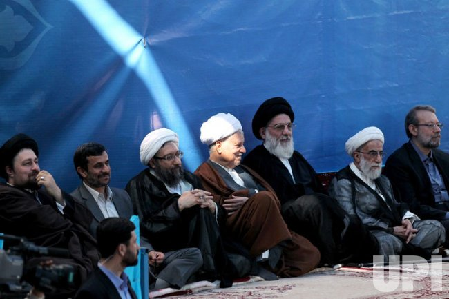 Iranian government officials attend a ceremony in Tehran